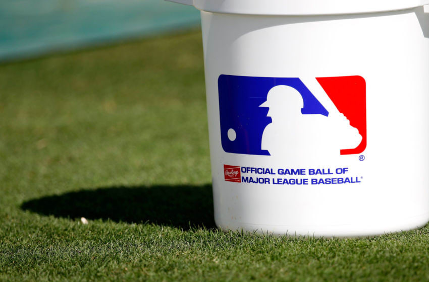 JUPITER, FL - MARCH 18: The Major League Baseball logo is printed on a bucket of baseballs at a game between the St. Louis Cardinals and the Miami Marlins at Roger Dean Stadium on March 18, 2012 in Jupiter, Florida. (Photo by Sarah Glenn/Getty Images)