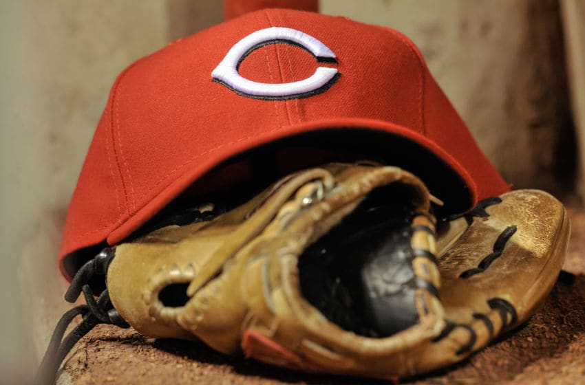CINCINNATI, OH - APRIL 5: A Cincinnati Reds players' glove and hat sit on the steps of the dugout. (Photo by Jamie Sabau/Getty Images)