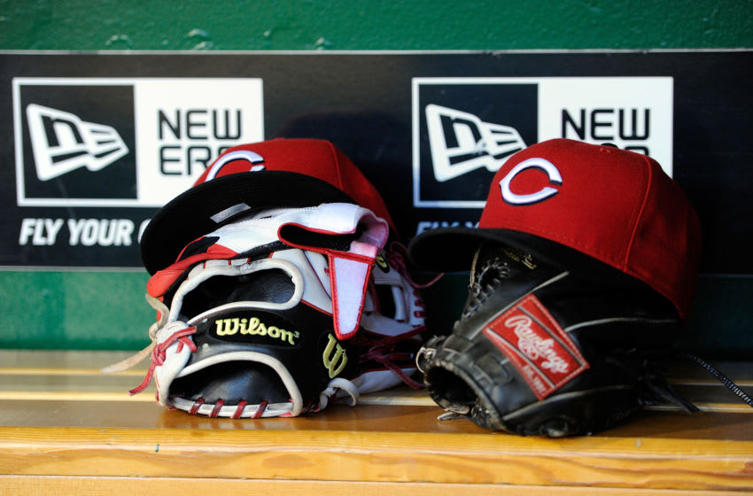 WASHINGTON, DC - APRIL 25: Cincinnati Reds hat and gloves in the dugout. (Photo by G Fiume/Getty Images)