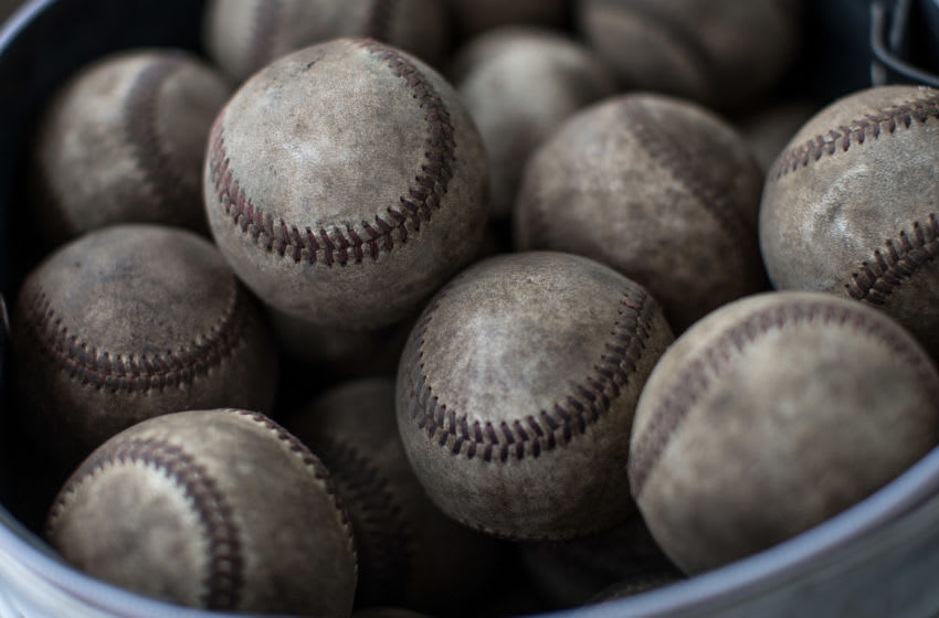 YOKOSUKA, JAPAN - JULY 30: (EDITORIAL USE ONLY) Used baseballs are seen in the dugout during a practice game between the Shonan Boys and the Yokohama Minami on July 30, 2014 in Yokosuka, Japan.(Photo by Chris McGrath/Getty Images)