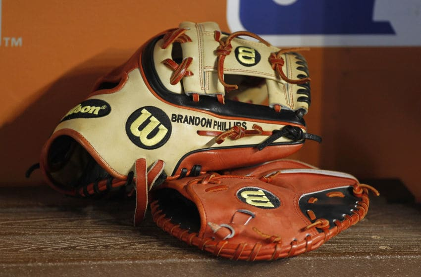MIAMI, FL - JULY 11: Gloves belonging to Brandon Phillips of the Cincinnati Reds are shown on the bench during batting practice before the Reds met the Miami Marlins at Marlins Park on July 11, 2015 in Miami, Florida. (Photo by Joe Skipper/Getty Images)