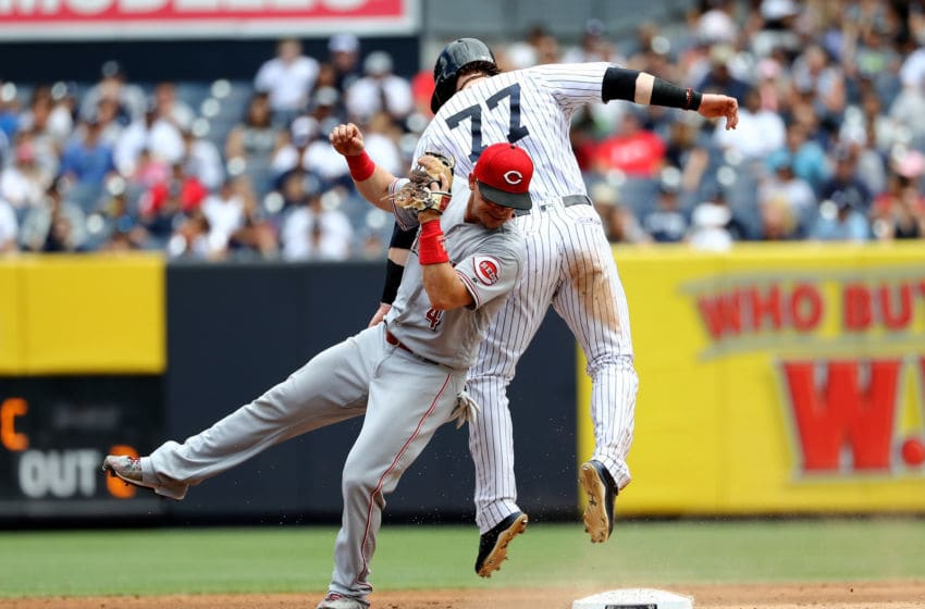 NEW YORK, NY - JULY 26: Clint Frazier #77 of the New York Yankees is out at second on a force out as Scooter Gennett #4 of the Cincinnati Reds makes the out in the fifth inning on July 26, 2017 at Yankee Stadium in the Bronx borough of New York City. (Photo by Elsa/Getty Images)