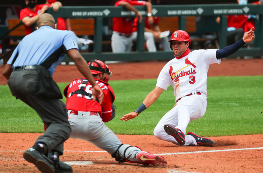ST LOUIS, MO - AUGUST 23: Dylan Carlson #3 of the St. Louis Cardinals attempts to score a run against the Cincinnati Reds in the fourth inning at Busch Stadium on August 23, 2020 in St Louis, Missouri. Carlson was out at the plate. (Photo by Dilip Vishwanat/Getty Images)