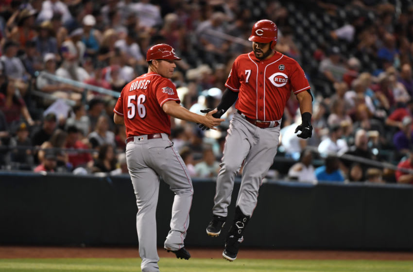 PHOENIX, ARIZONA - SEPTEMBER 15: Eugenio Suarez #7 of the Cincinnati Reds celebrates with third base coach JR House #56 after hitting a solo home run off of Zac Gallen #59 of the Arizona Diamondbacks during the sixth inning at Chase Field on September 15, 2019 in Phoenix, Arizona. It was the second home run of the game for Suarez. (Photo by Norm Hall/Getty Images)