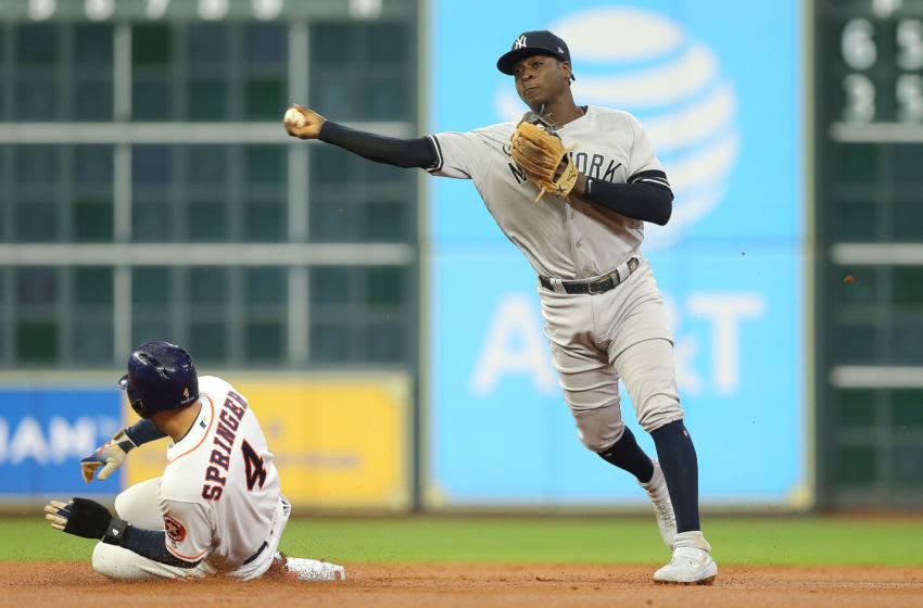 HOUSTON, TEXAS - OCTOBER 13: Didi Gregorius #18 of the New York Yankees turns a double play during the first inning against the Houston Astros in game two of the American League Championship Series at Minute Maid Park on October 13, 2019 in Houston, Texas. (Photo by Bob Levey/Getty Images)