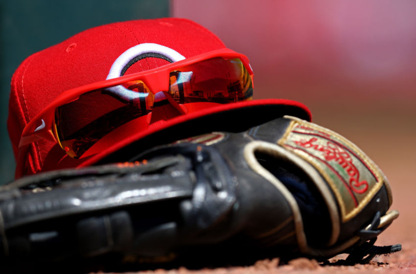 Apr 3, 2019; Cincinnati, OH, USA; A view of the stadium reflection in the Nike sunglasses on a Reds hat in the dugout in the game against the Milwaukee Brewers at Great American Ball Park. Mandatory Credit: Aaron Doster-USA TODAY Sports
