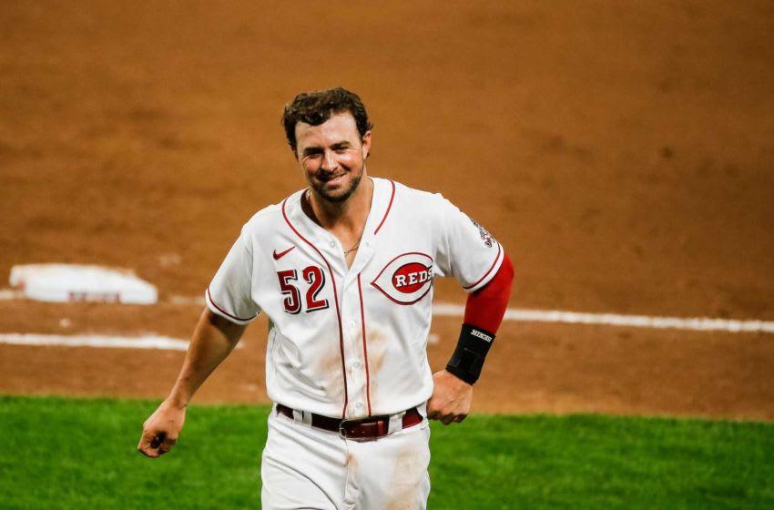Cincinnati Reds second baseman Kyle Farmer (52) walks off the field.