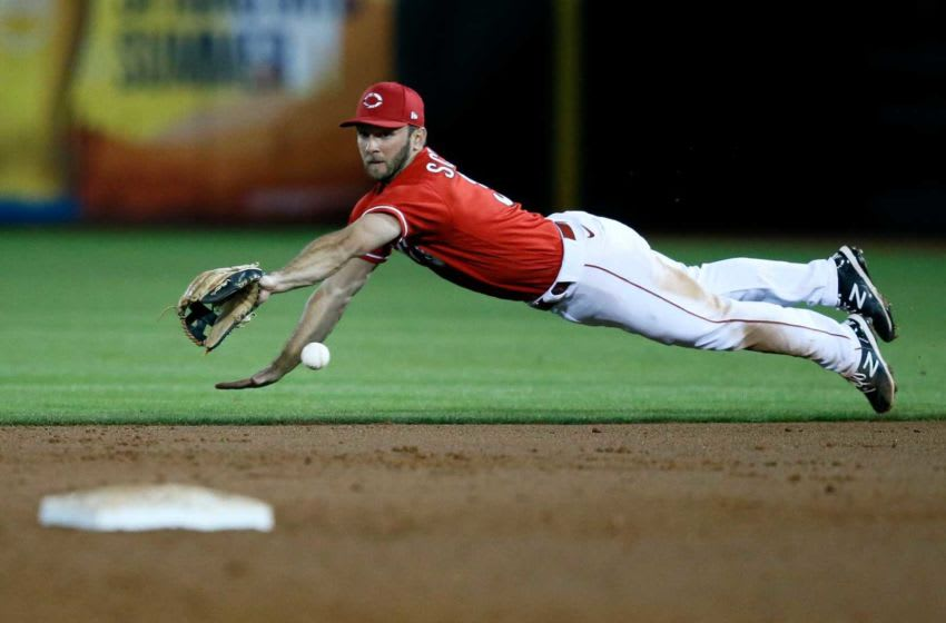 Cincinnati Reds second baseman Max Schrock (32) dives, but is unable to catch up to a ground ball.