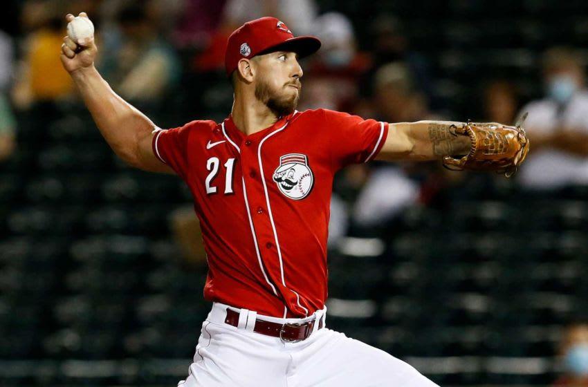 Cincinnati Reds relief pitcher Michael Lorenzen (21) throws a pitch.
