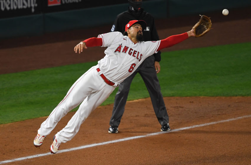 Apr 4, 2021; Anaheim, California, USA; Los Angeles Angels third baseman Anthony Rendon (6) cannot reach a throw from relief pitcher Raisel Iglesias (32) allowing Chicago White Sox second baseman Nick Madrigal (1) to score from second base. Mandatory Credit: Jayne Kamin-Oncea-USA TODAY Sports