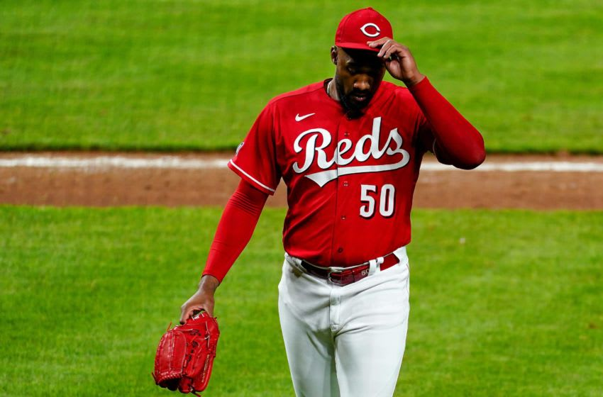 Cincinnati Reds relief pitcher Amir Garrett (50) walks to the dugout after surrendering a three-run home run.