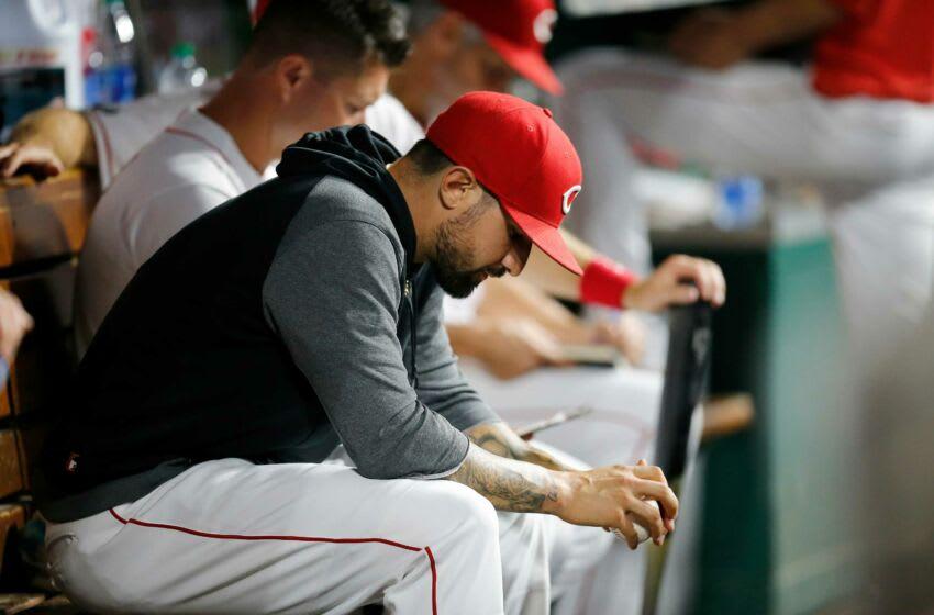 Injured Cincinnati Reds right fielder Nick Castellanos (2) sits in the dugout.