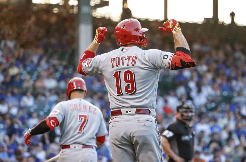 Jul 27, 2021; Chicago, Illinois, USA; Cincinnati Reds first baseman Joey Votto (19) celebrates after hitting a solo home run. Mandatory Credit: Kamil Krzaczynski-USA TODAY Sports