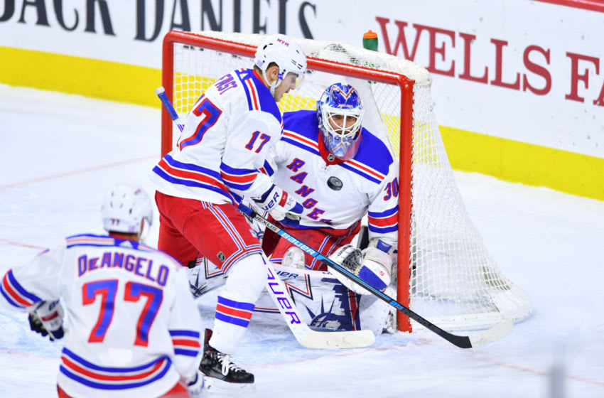 PHILADELPHIA, PA - NOVEMBER 23: New York Rangers Goalie Henrik Lundqvist (30) eyes up a puck in mid-air collected by Right Wing Jesper Fast (17) in the first period during the game between the Philadelphia Flyers and New York Rangers on November 23, 2018 at Wells Fargo Center in Philadelphia, PA. (Photo by Kyle Ross/Icon Sportswire via Getty Images)