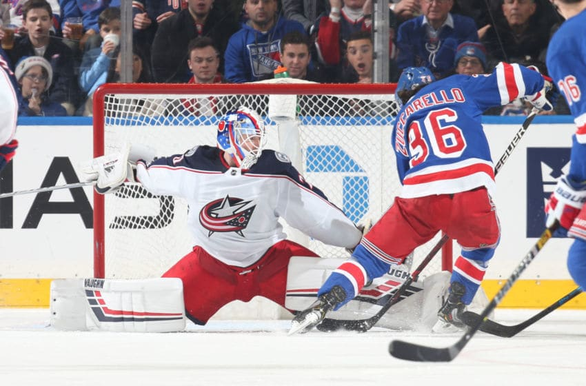 NEW YORK, NY - DECEMBER 27: Joonas Korpisalo #70 of the Columbus Blue Jackets makes a save against Mats Zuccarello #36 of the New York Rangers at Madison Square Garden on December 27, 2018 in New York City. (Photo by Jared Silber/NHLI via Getty Images)