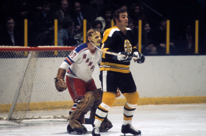 NEW YORK, NY - 1971: Ken Hodge #8 of the Boston Bruins tries to screen goalie Gilles Villemure #30 of the New York Rangers during their game circa 1971 at the Madison Square Garden in New York, New York. (Photo by Melchior DiGiacomo/Getty Images)