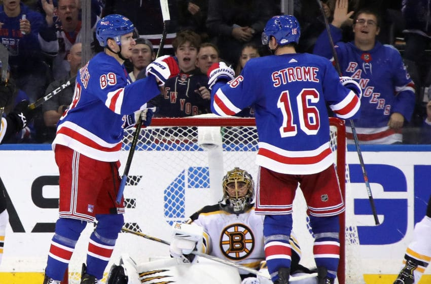 NEW YORK, NEW YORK - OCTOBER 27: Pavel Buchnevich #89 of the New York Rangers celebrates his third period goal along with Ryan Strome #16 against Jaroslav Halak #41 of the Boston Bruins during the third period at Madison Square Garden on October 27, 2019 in New York City. The Bruins defeated the Rangers 7-4. (Photo by Bruce Bennett/Getty Images)