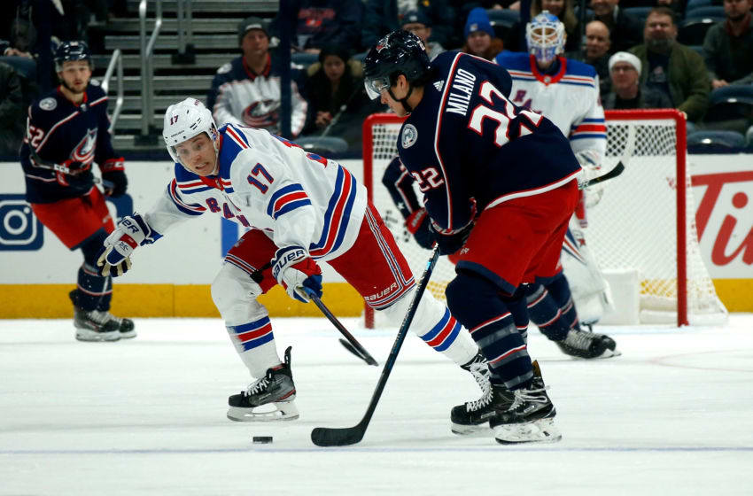 COLUMBUS, OH - DECEMBER 5: Jesper Fast #17 of the New York Rangers attempts to steal the puck from Sonny Milano #22 of the Columbus Blue Jackets during the game on December 5, 2019 at Nationwide Arena in Columbus, Ohio. (Photo by Kirk Irwin/Getty Images)