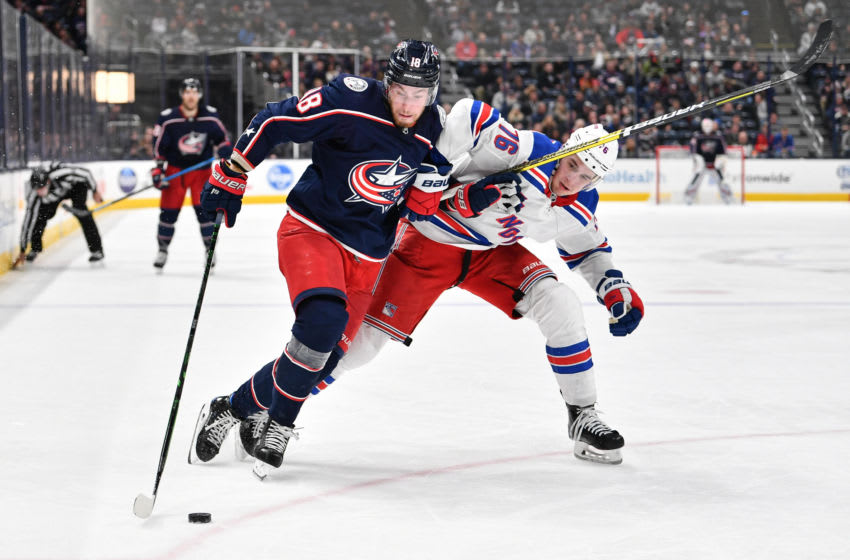COLUMBUS, OH - DECEMBER 5: Pierre-Luc Dubois #18 of the Columbus Blue Jackets battles with Brady Skjei #76 of the New York Rangers for control of the puck on December 5, 2019 at Nationwide Arena in Columbus, Ohio. (Photo by Jamie Sabau/NHLI via Getty Images)
