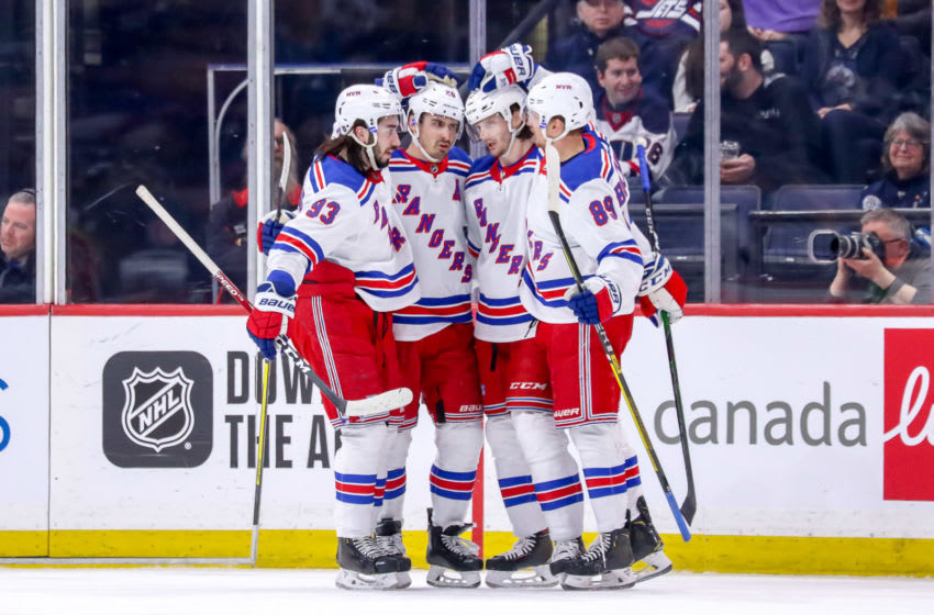 WINNIPEG, MB - FEBRUARY 11: Mika Zibanejad #93, Chris Kreider #20, Jacob Trouba #8 and Pavel Buchnevich #89 of the New York Rangers celebrate a first period goal against the Winnipeg Jets at the Bell MTS Place on February 11, 2020 in Winnipeg, Manitoba, Canada. (Photo by Darcy Finley/NHLI via Getty Images)