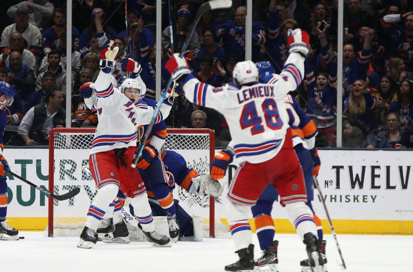 NEW YORK, NEW YORK - FEBRUARY 25: Julien Gauthier #12 of the New York Rangers (L) celebrates a second period goal by v14#@ against the New York Islanders at NYCB Live's Nassau Coliseum on February 25, 2020 in Uniondale, New York. (Photo by Bruce Bennett/Getty Images)