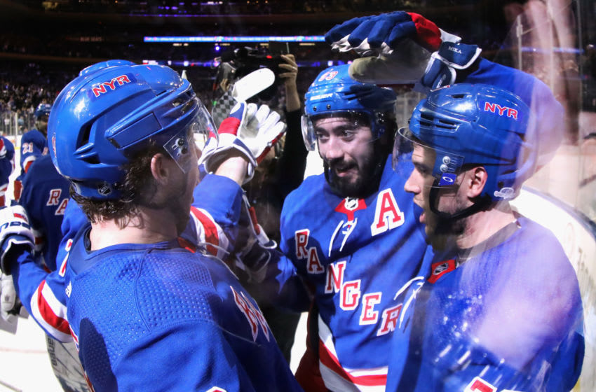 NEW YORK, NEW YORK - MARCH 05: Brendan Lemieux #48, Mika Zibanejad #93 and Tony DeAngelo #77 of the New York Rangers celebrate a 5-4 overtime victory over the Washington Capitals at Madison Square Garden on March 05, 2020 in New York City. (Photo by Bruce Bennett/Getty Images)