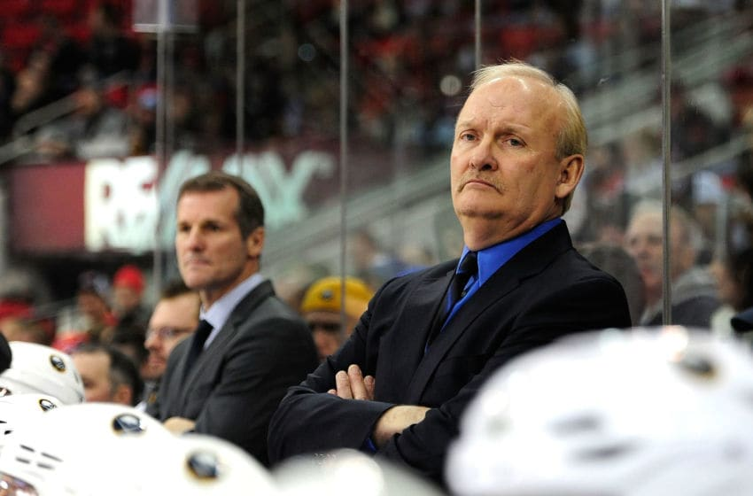 RALEIGH, NC - JANUARY 24: Coach Lindy Ruff of the Buffalo Sabres against the Carolina Hurricanes during play at PNC Arena on January 24, 2013 in Raleigh, North Carolina. Carolina defeated Buffalo, 6-3. (Photo by Grant Halverson/Getty Images)