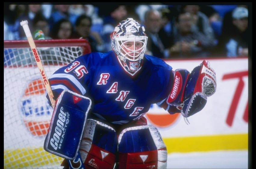 13 Dec 1996: Goaltender Mike Richter of the New York Rangers looks on during a game against the Buffalo Sabres at the Marine Midland Arena in Buffalo, New York. The Rangers won the game, 3-0.