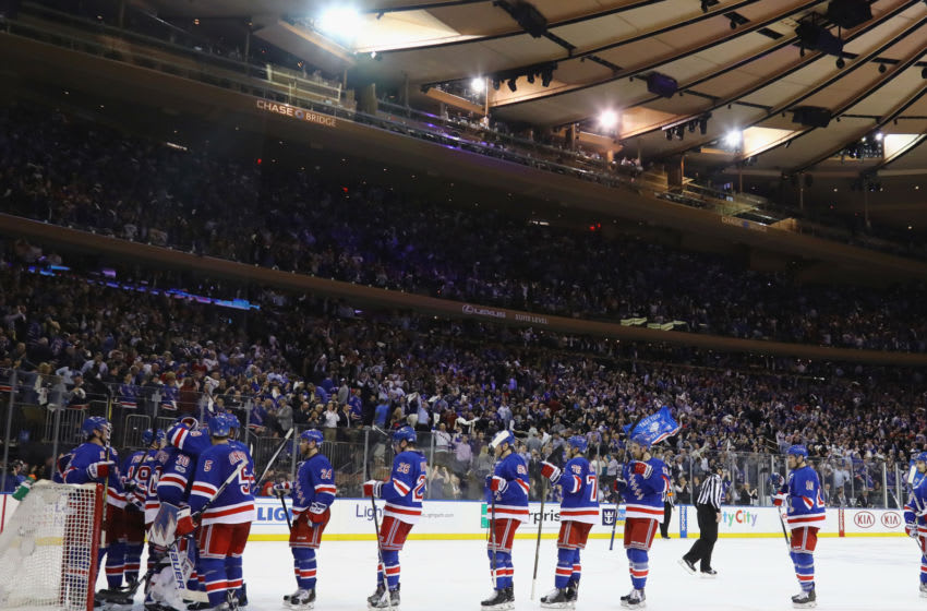 The New York Rangers celebrate a 2-1 victory (Photo by Bruce Bennett/Getty Images)