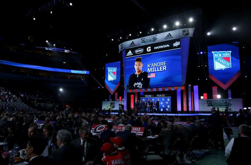 K'Andre Miller poses after being selected twenty-second overall by the New York Rangers . (Photo by Bruce Bennett/Getty Images)