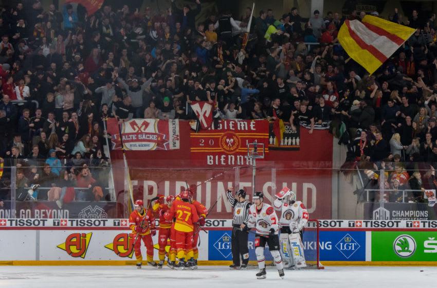 BIEL, SWITZERLAND - DECEMBER 10: EHC Biel-Bienne players celebrate a goal during the second quarter-finals game between EHC Biel-Bienne and Frolunda Indians at Tissot-Arena on December 10, 2019 in Biel, Switzerland. (Photo by RvS.Media/Basile Barbey/Getty Images)