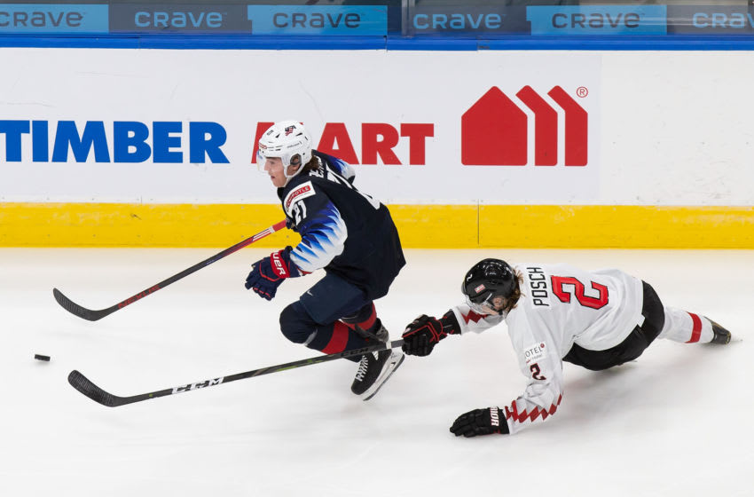 EDMONTON, AB - DECEMBER 26: Brett Berard #21 of the United States skates against Bernhard Posch #2 of Austria during the 2021 IIHF World Junior Championship at Rogers Place on December 26, 2020 in Edmonton, Canada. (Photo by Codie McLachlan/Getty Images)