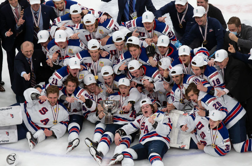 EDMONTON, AB - JANUARY 05: The United States team celebrates its victory over Canada during the 2021 IIHF World Junior Championship gold medal game at Rogers Place on January 5, 2021 in Edmonton, Canada. (Photo by Codie McLachlan/Getty Images)