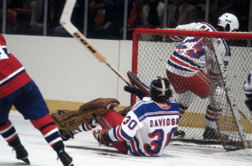 NEW YORK - CIRCA 1979: Goalie John Davidson #30 of the New York Rangers defends his goal against the Montreal Canadiens during an NHL Hockey game circa 1979 at Madison Square Garden in the Manhattan borough of New York City. Davidson's playing career went from 1973-83. (Photo by Focus on Sport/Getty Images)