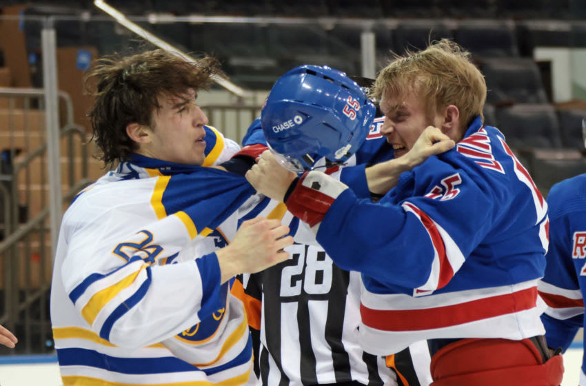 NEW YORK, NEW YORK - MARCH 02: Ryan Lindgren #55 of the New York Rangers and Dylan Cozens #24 of the Buffalo Sabres fight during the third period at Madison Square Garden on March 02, 2021 in New York City. (Photo by Bruce Bennett/Getty Images)