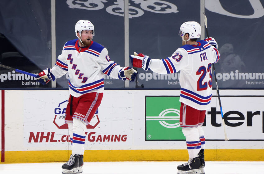 UNIONDALE, NEW YORK - APRIL 09: Alexis Lafreniere #13 (L) celebrates his second period goal against the New York Islanders and is joined by Adam Fox #23 (R) at Nassau Coliseum on April 09, 2021 in Uniondale, New York. (Photo by Bruce Bennett/Getty Images)