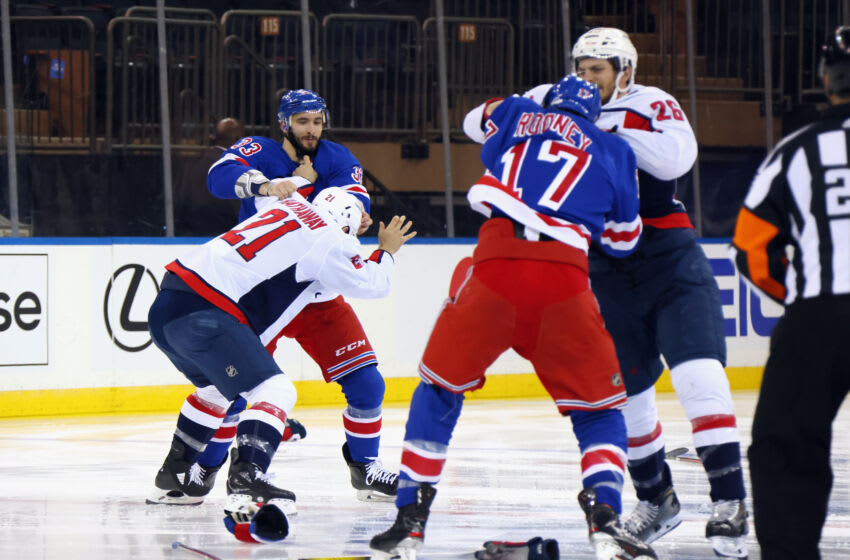 NEW YORK, NEW YORK - MAY 05: The game between the Washington Capitals and the New York Rangers starts with a line brawl one second into play at Madison Square Garden on May 05, 2021 in New York City. (Photo by Bruce Bennett/Getty Images)