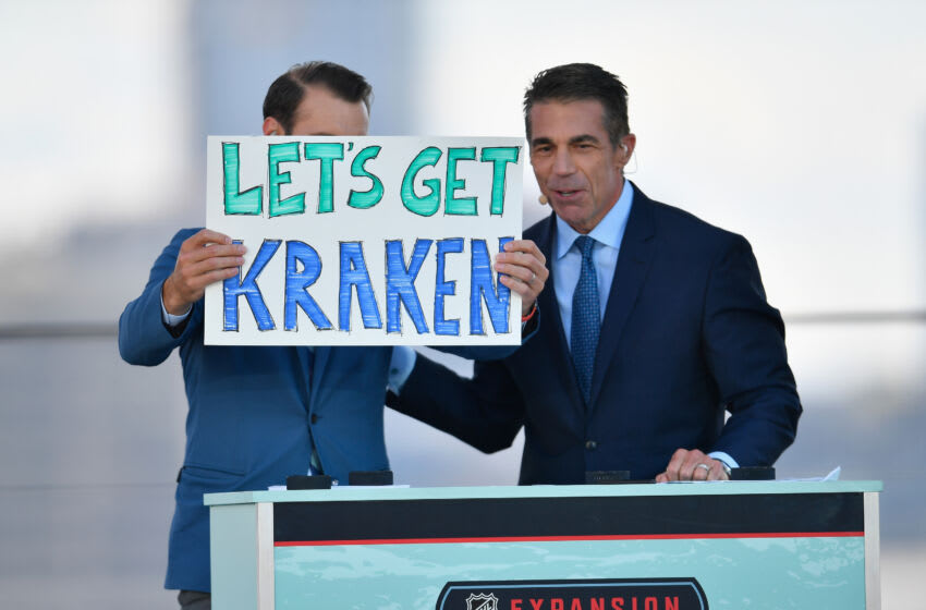 SEATTLE, WASHINGTON - JULY 21: Former NHL player Dominic Moore (L) and broadcaster Chris Fowler host the 2021 NHL Expansion Draft at Gas Works Park on July 21, 2021 in Seattle, Washington. The Kracken is the National Hockey League's newest franchise and will begin play in October 2021. (Photo by Alika Jenner/Getty Images)
