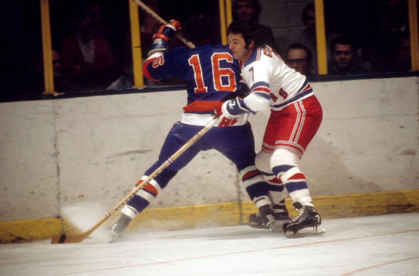 NEW YORK, NY - 1973: Rod Gilbert #7 of the New York Rangers looks to check Ralph Stewart #16 of the New York Islanders during their game circa 1973 at the Madison Square Garden in New York, New York. (Photo by Melchior DiGiacomo/Getty Images)