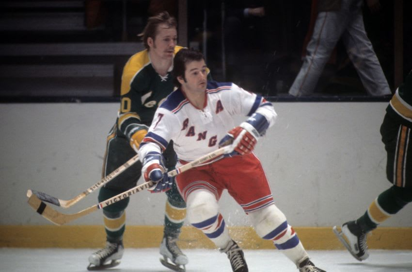 Rod Gilbert #7 of the New York Rangers skates on the ice during an NHL game against the California Golden Seals . (Photo by Melchior DiGiacomo/Getty Images)