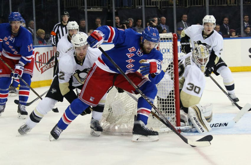 NEW YORK, NY - APRIL 21: Ben Lovejoy #12 of the Pittsburgh Penguins checks Rick Nash #61 of the New York Rangers during the second period in Game Four of the Eastern Conference First Round during the 2016 NHL Stanley Cup Playoffs at Madison Square Garden on April 21, 2016 in New York City. (Photo by Bruce Bennett/Getty Images)