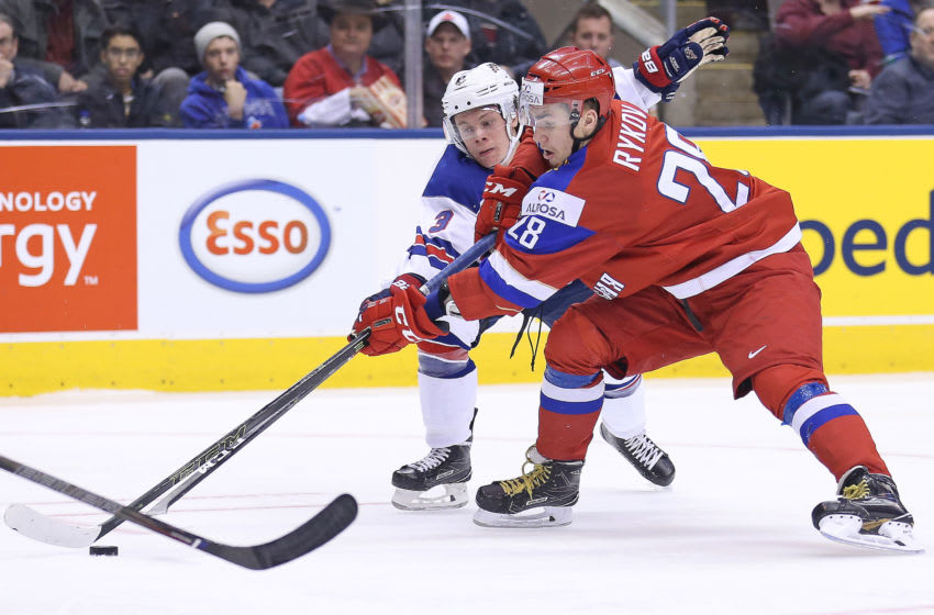 TORONTO, ON - DECEMBER 26: Jack Ahcan #3 of Team USA battles against Yegor Rykov #28 of Team Russia during a preliminary game at the 2017 IIHF World Junior Hockey Championship at the Air Canada Centre on December 29, 2016 in Toronto, Ontario, Canada. Team USA defeated Team Russia 3-2. (Photo by Claus Andersen/Getty Images)