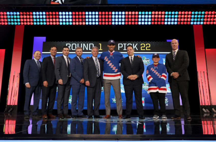 DALLAS, TX - JUNE 22: K'Andre Miller poses after being selected twenty-second overall by the New York Rangers during the first round of the 2018 NHL Draft at American Airlines Center on June 22, 2018 in Dallas, Texas. (Photo by Bruce Bennett/Getty Images)