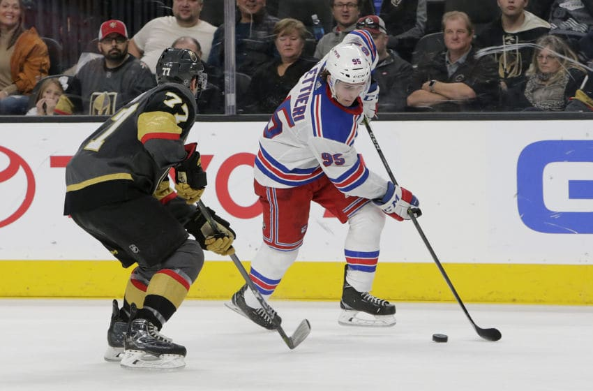 LAS VEGAS, NV - JANUARY 07: New York Rangers center Vinni Lettieri (95) moves the puck during the second period of a regular season game between the New York Rangers and the Vegas Golden Knights at T-Mobile Arena Sunday, Jan. 7, 2018, in Las Vegas, Nevada. (Photo by: Marc Sanchez/Icon Sportswire via Getty Images)