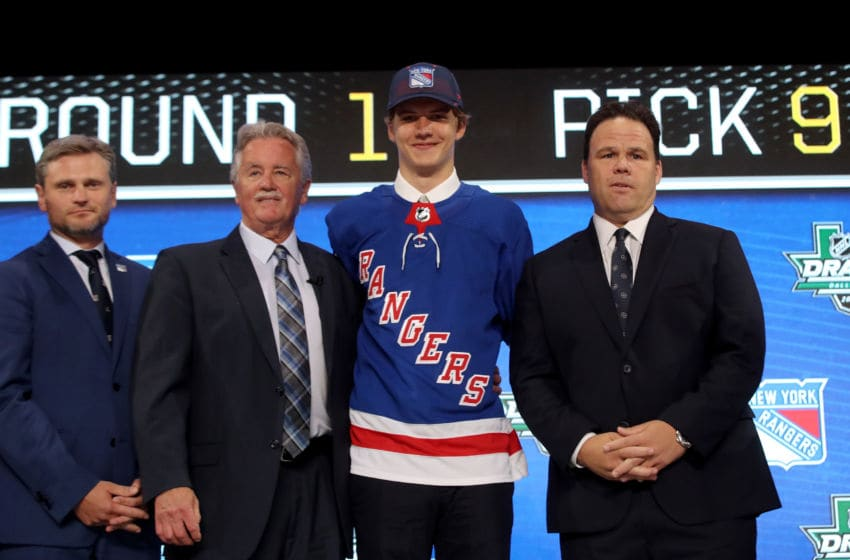 Vitali Kravtsov posesafter being selected ninth overall by the New York Rangers (Photo by Bruce Bennett/Getty Images)