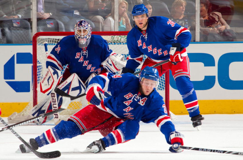 NEW YORK - SEPTEMBER 29: Michael Sauer #38, Ryan Callahan #24, and Henrik Lundqvist #30 of the New York Rangers protect the net against the Detroit Red Wings on September 29, 2010 at Madison Square Garden in New York City. The Rangers defeat the Red Wings 5-1. (Photo by Rebecca Taylor/MSG Photos/Getty Images)
