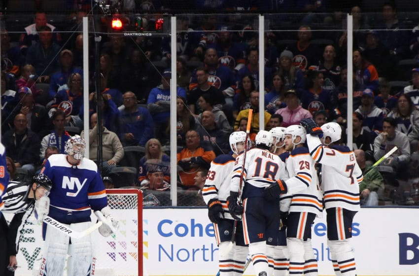 NEW YORK, NEW YORK - OCTOBER 08: James Neal #18 of the Edmonton Oilers scores his hat-trick goal on the power-play at 6:31 of the third period against the New York Islanders at NYCB's LIVE Nassau Coliseum on October 08, 2019 in Uniondale, New York. (Photo by Bruce Bennett/Getty Images)