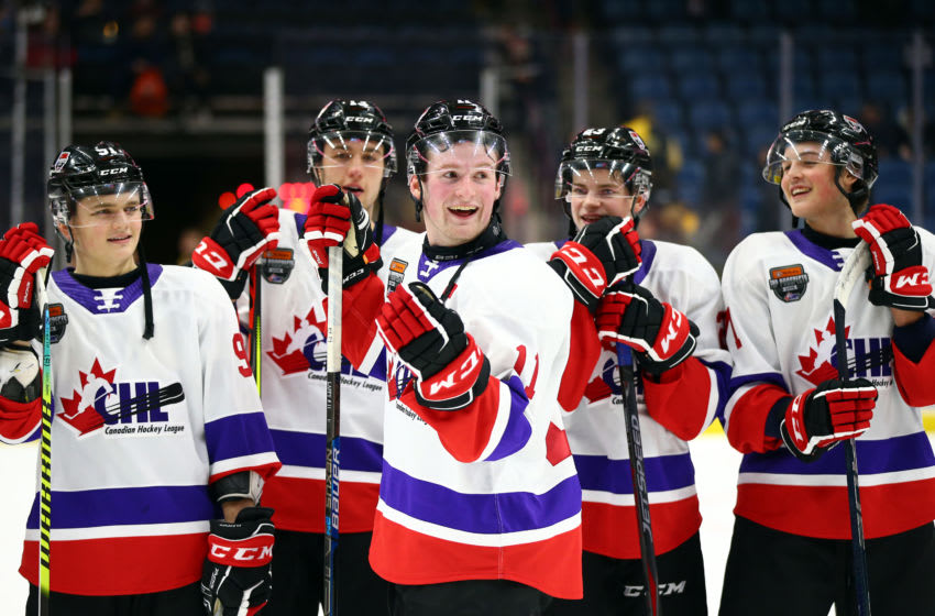 Alexis Lafreniere #11 of Team White laughs with teammates following the final whistle of the 2020 CHL/NHL Top Prospects Game against Team Red. (Photo by Vaughn Ridley/Getty Images)