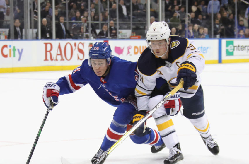 Jack Eichel #9 of the Buffalo Sabres skates against Kaapo Kakko #24 of the New York Rangers (Photo by Bruce Bennett/Getty Images)