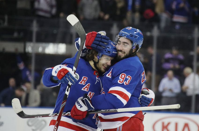Artemi Panarin #10 and Mika Zibanejad #93 of the New York Rangers celebrate a 5-4 overtime victory over the Washington Capitals. (Photo by Bruce Bennett/Getty Images)